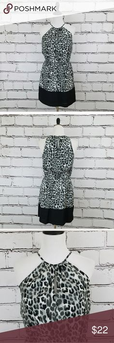 Express Cheetah Print Dress Black, white and gray colored cheetah print dress. Halter style neckline. Elastic waist. Length is about 36 inches and armpit to armpit is about 17 inches. Like new condition! Express Dresses Midi