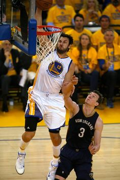 Description of . Golden State Warriors' Andrew Bogut (12) dunks the ball against New Orleans Pelicans' Omer Asik (3) in the first quarter of Game 2 of the first round of the NBA Western Conference playoffs at Oracle Arena in Oakland, Calif., on Monday, April 20, 2015.  (D. Ross Cameron/Bay Area News Group)