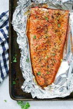 Spicy Butter Salmon in Foil. This Salmon in Foil is made with melted butter and lots of spices. Its cooked in 20 minutes then broiled for the crispy finish! Salmon In Foil Recipes, Best Salmon Recipe, Healthy Salmon Recipes, Fish Recipes, Lunch Recipes, Seafood Recipes, Cooking Recipes, Healthy Foods, Dinner Recipes