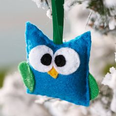 Skip the traditional red and green, and craft this cute baby owl ornament from teal and green felt instead. To make, trace patterns onto white… Christmas Ornaments To Make, Felt Ornaments, Christmas Projects, Felt Crafts, Holiday Crafts, Winter Christmas, Christmas Decorations, Christmas Trees, Handmade Ornaments
