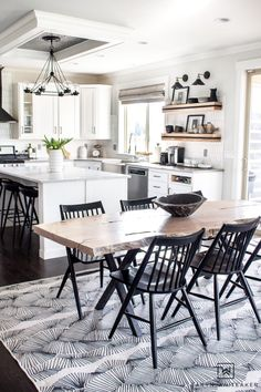 Spring Decor Ideas -black and white Scandinavian inspired kitchen with wood open shelving and live edge table Gallery Wall Staircase, Staircase Wall Decor, Beautiful Kitchen Designs, Beautiful Kitchens, New Kitchen, Kitchen Decor, Live Edge Table, Modern Ceramics, Cool Diy Projects