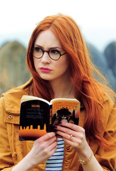 Can we take a moment to talk about the title of the book she's holding?