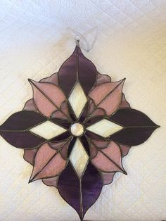 Purple stained glass suncatched with clear bevels, approx. 16 in diameter I can custom make any Design with desired color or size for your setting. All I need is measurements and a photo