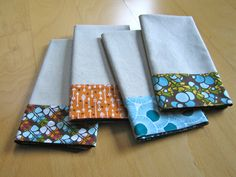 A great tutorial for napkins edged with lovely material.  I like this idea for several reasons: I prefer light-coloured, mostly plain napkins; I don't want to wipe my mouth on pretty (and usually expensive) fabric; and it's a good way to use up smaller scraps of material.