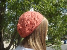 """Slouchy Hat Hand Crocheted Orange Pink Color Very by WillowPrairie, $24.00 This hat is perfect for spring! It can be worn slouched to the side or to the back. I love this hat when I am having a bad hair day.  Ready to ship.  Size: adult or teen (21"""" with stretch) Color: Orange pink Fiber: Acrylic  Machine wash and dry!  I am able to make a variety of sizes and colors, so please feel free to contact me with your request."""