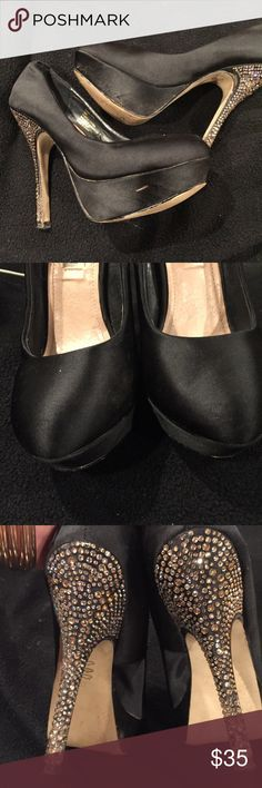 Black satin Steve Madden dressy shoes. Black satin Steve Madden dressy shoes. Bling bling dance away 5 inch heel with an inch wedge in front of the shoe.  They look absolutely fabulous they been danced on but can still do some more dancing. Steve Madden Shoes Heels
