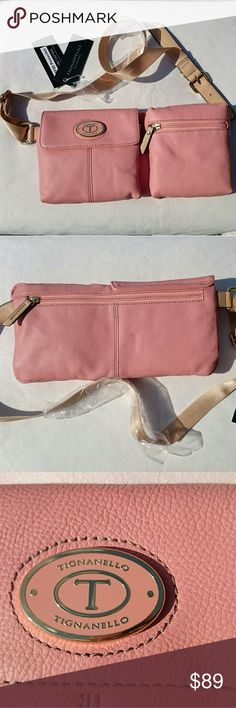 SALE! Tignanello Leather Peach Belt Bag NWT! NWT! Super cute! New stylish twist on the fanny pack. Peach Tignanello belt bag. Genuine leather! 2 large pockets...one with magnetic snap closure & small inside pocket...the other large pocket has a zipper closure. Backside has a large zippered pocket where you keep your $ and credit cards. 5 credit card slots with built in RFID protection to protect your info being stolen! Adjustable strap. An essential addition to your spring/summer wardrobe…