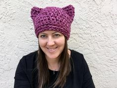 Make a statement with this Pink and Purple Cat Hat that has been made so popular by the Women's March on Washington. Made with super bulky yarn, this extra thick beanie will keep you warm in the cold winter weather.Hat is crocheted flat in a square shape and seamed across the top. Ears appear when you put it on.Fits average woman's size head, 21-23 inches around (measured across the forehead, just above the ears).Care instruction:Made with an acrylic/wool blend yarn, this hat can...