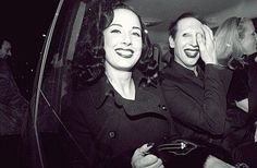 Picture Nr.2 of the two most beautiful pictures of Dita Von Teese and Marilyn Manson! Why? I love this Photo so much because it shows an extreme authentic moment! Normally Dita and Marilyn are Performers. When they see cameras holding on them they always show a mask. Also as they were together. They always smiled into the camera but in some way it always was posed. This photo is the absolute contrary of this. Dita and Marilyn smile and laugh but it seems like the photographer caught them in…