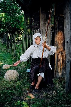 Wow!  Chunky yarn!   Romania spinner with spindle and distaff