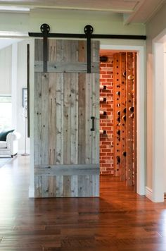 Sliding barn door opens up to wine cellar!