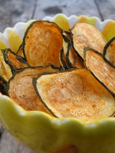 Baked Zucchini Chips!  Zucchini, canola cooking spray, seasoned salt or other seasoning(s).  Spray parchment paper or nonstick foil with canola oil.  Slice zucchini into thin medallions.  Lay out slices on prepared baking sheet, and spray tops lightly with additional cooking spray.  Season. Bake 30 min, rotate, and bake 30-50 additional mins.