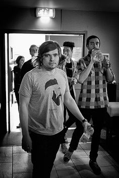 Bastille, the man who you see in the front is Woody, the one drinking water is Kyle, Dan is behind Kyle, and will is behind Woddy