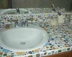 Mosaic Tile Counter Tops- turn those old laminate countertops into a work of art!!!  I'm doing this!