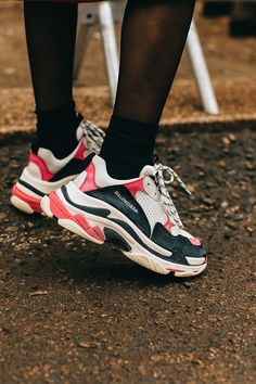 In the streets of Milan, we spotted all the latest luxury sneaker styles, from Burberry's latest low-tops to chunky sneakers from Gucci and Balenciaga.