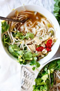 Spicy Thai Noodle Bowls - Such an easy and yummy dish! The perfect combination of soft rice noodles and flavor packed broth. #GlutenFree -- http://TheGarlicDiaries.com