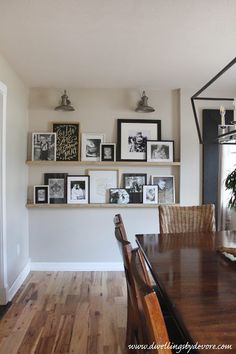 Creative ways to display family photos. If you need ideas for how to display your latest family photo session, this post is full of great ideas! wall ideas 7 Creative Ways to Display Family Photos - Love & Renovations Display Family Photos, Photo Ledge Display, Display Pictures, Displaying Family Pictures, Picture Frame Display, Family Pictures On Wall, Shelves With Pictures, Picture Frame Walls, Photo Wall Displays