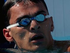 Alex Popov, greatest sprint freestyler of all time. Swimming Pictures, Round Sunglasses, Mens Sunglasses, All About Time, Articles, Round Frame Sunglasses, Men's Sunglasses