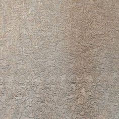 A soft metallic brocade in gold. Features a crinkled, almost quilted effect. Pliant and soft drape. We see this fabric as jackets, dresses, tunics, accent pieces and more.