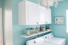 cheerful laundry room with cute light fixture