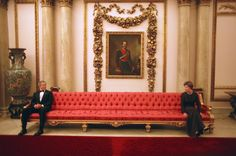 President George Bush and wife Laura, on a visit to Buckingham Palace.  I find this quite comical - don't get too close in the Palace.