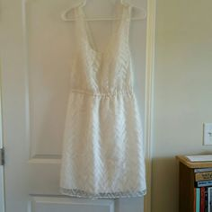 Madewell Broadway/Broome white lace cut out dress Gorgeous lightweight white dress with patterned lacy overlay. The back is partially open with beautiful twisted lace knotwork. It's a great mix of feminine and delicate and a bit sexy. Would be great for a bridal shower or just a spring day! Size 10 bit due to the elastic waist could also comfortably fit a 6-8 or maybe 12. Worn twice and then dry cleaned. There is a small discoloration from makeup on the inside of the dress near the waistband…
