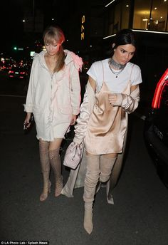 Kendall Jenner slips into slinky satin dress and over-the-knee boots while Gigi Hadid covers up in baggy jacket as they party after the MTV Movie Awards | Daily Mail Online