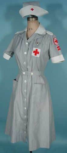 """c. 1942-1947 Mercantile Uniforms, New York:WWII """"Gray Lady"""" Red Cross Uniform/American Red Cross Volunteer Outfit.  AKA Hospital and Recreation Corps. Uniform.  The gray and white thin striped cotton dress and additional pieces of the white epaulets, white collar, gray matching belt and cap are all separate pieces.  The American Red Cross Volunteer pin is pinned on the chest pocket above the large red cross embroidered patch. This one is dated 1942; the year they removed the veil from the…"""