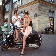 In Paris, on a moped. so envious of this girl
