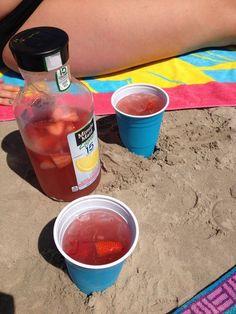 Bottle of pink lemonade, Malibu rum, watermelon vodka, and fresh strawberries!