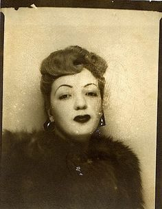 Vintage photo booth pic of woman with hand-drawn eyebrows