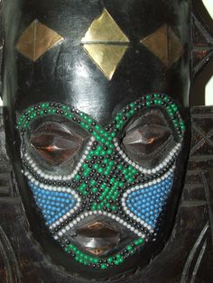 Vintage Hand Carved African Tribal Mask with Inlaid Beads and Brass Decorations