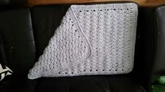 Crocheted baby blanket. Puff stitch with a double crochet rim, finished with a crab stitch trim.