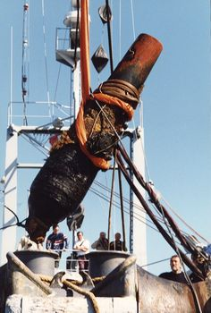 Blakely Cannon from the CSS Alabama being raised in 1994.  Beside the Blakely canon and its pivoting chassis, the operation lifted a great number of objects from the officers' mess, as well as personal effects, such as fashion accessories, tools, revolver bullets, a sperm-whale tooth, and coins.
