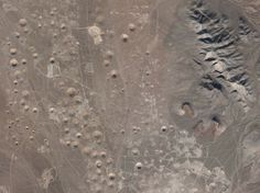 Satellite view of Yucca Flat, one of the Nevada Nuclear Test Sites; over 739 nuclear tests were run between 1951 and 1992 which has left the region scarred and pockmarked to this day