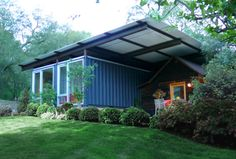 five shipping containers.    Read more: http://www.dwell.com/slideshows/self-contained.html?slide=1=y=true#ixzz22zlLJQKX. This would so cool