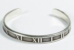 Lot 526: Tiffany & Co. Sterling Silver Atlas Cuff Bracelet; 1995, marked inside band