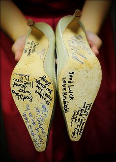Soles of shoes signed by bridesmaids - Photo by Jason