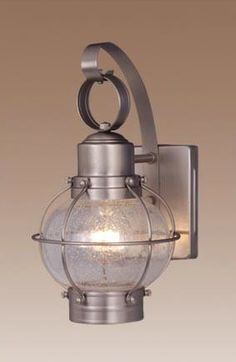 Features:  -7'' Outdoor wall lantern.  -Seeded glass.  -Lantern is attached in the back to avoid swaying..  Fixture Type: -Wall lantern.  Fixture Material: -Metal.  Hardware Material: -Stainless steel