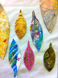 Painted paper feathers for an artful dreamcatcher (on Free People)