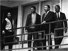 King stands with other civil rights leaders on the balcony of the Lorraine Motel in Memphis, Tenn., on April 3, 1968, a day before he was assassinated at approximately the same spot. From left: Hosea Williams, Jesse Jackson, King and Ralph Abernathy.    Credit: AP