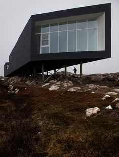 Stunning Inspirations for Studio Artist from Fogo Island: Fascinating Fogo Island Long Studio Exterior View With Black Wall And White Framed...