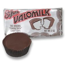 Valomilk Candy Cups: 1931 A lucky accident involving marshmallow at the Sifer's Candy Company leads to the creation of the Valomilk Candy Bar, originally known as Valomilk Dips.