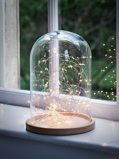 Suitable for both indoor and outdoor use, these pure white LED lights are strung on a thin clear wire that's almost invisible, so all you see is the glow of the tiny bulbs. So versatile, they look great draped around your banister, bunched up in a vase or on your Christmas tree, and come in a variety of lengths.
