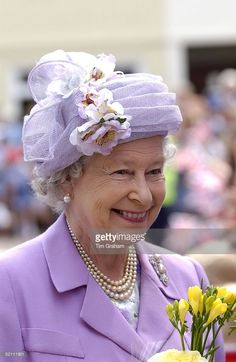 The Queen Smiling And Holding Flowers During A Walkabout In Kettering, Northamptonshire.