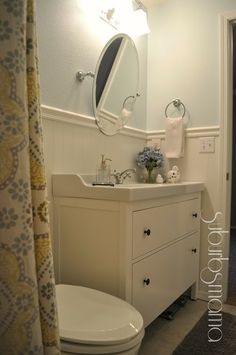 Shower curtain is from World Market, the paint color top sail by Sherwin Williams
