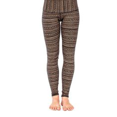 "Women's legging featuring striped tribal all-over print ""EarthTRiBE"" These pants come in two material weights, a warmer heavyweight cotton and a lightweight breathable cotton. Wide waist band hugs curves and can be folded over for a low or high rise. Designed by AndreasOne for PEACEfits"