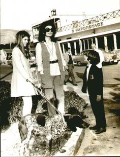 Jackie Onassis, Caroline and John Kennedy at the Athens airport, 1970.