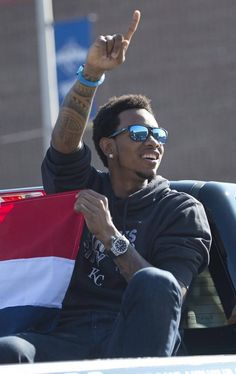 Sporting the flag of his native Dominican Republic, Royals pitcher Yordano Ventura acknowleded the fans along that lined Grand Boulevard during the World Series victory parade on Tuesday, Nov. 3, 2015 in Kansas City.