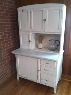 I would love to have this!  Vintage Hoosier Cabinet by ValiantRoseDesigns on Etsy, $500.00